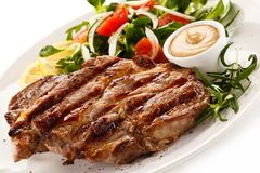 Grilled steaks and vegetables royalty free stock photo