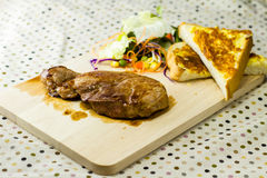 Grilled steaks on wood Stock Photo