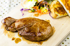 Grilled steaks on wood Stock Image