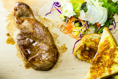 Grilled steaks on wood Stock Photos