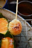 Grilled sticky rice with egg on gridiron Stock Photos