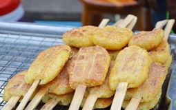 Grilled sticky rick with egg in the morning market Stock Photography