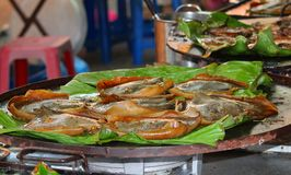 Grilled stingray on banana leaves Stock Photo