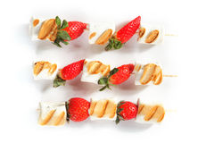 Grilled Strawberry and Marshmallows on Sticks Royalty Free Stock Photos