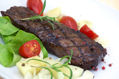 Grilled strip steak  with tomato and salad Stock Photos