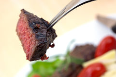 Grilled strip steak  with tomato and salad Stock Photography