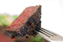 Grilled strip steak  with tomato and salad Royalty Free Stock Photography