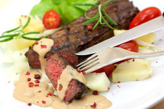 Grilled strip steak  with tomato and salad Royalty Free Stock Photo