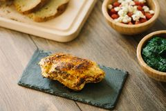 Grilled, stuffed chicken breast with bread and salad. royalty free stock photo