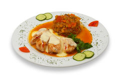 Grilled stuffed chicken fillet. Under white sauce with stewed vegetable garnish, isolated Stock Photography
