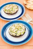 Grilled stuffed portobello mushrooms with feta cheese and scalli. Ons. selective focus, shallow dof Royalty Free Stock Photos