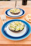 Grilled stuffed portobello mushrooms with feta cheese and scalli. Ons. selective focus, shallow dof Royalty Free Stock Photo