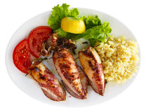 Grilled stuffed squids with rice royalty free stock image