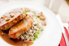 Grilled succulent pork chop and rice as main course Stock Photography