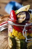 Grilled summer vegetables in glass jar Stock Photography