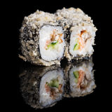 Grilled sushi rolls with salmon and eel Stock Image