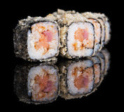 Grilled sushi rolls with salmon, tuna and eel Stock Photography
