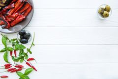 Grilled sweet paprika and basil leaves on white table stock photos