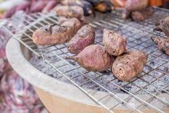 Grilled sweet potato on sieve Royalty Free Stock Photos