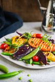 Grilled Sweet Potatoes with Snap pea and Rocket Salad Royalty Free Stock Photography