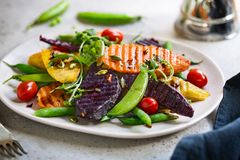 Grilled Sweet Potatoes with Snap pea and Rocket Salad Royalty Free Stock Image