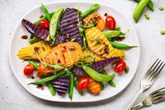 Grilled Sweet Potatoes with Snap pea and Rocket Salad Royalty Free Stock Photo