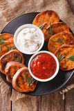Grilled sweet potatoes with sour cream and ketchup closeup. vert Royalty Free Stock Photos