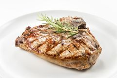 Grilled t-bone chop of pork. Dish with Grilled t-bone chop of pork stock photos