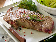 Grilled t-bone with  salad Royalty Free Stock Photography