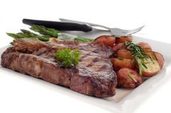 Grilled T-bone Steak. With rosemary potatoes and asparagus Stock Images