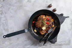 Grilled t-bone steak with butter Royalty Free Stock Images
