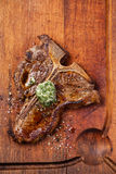 Grilled T-Bone Steak and butter with herbs Royalty Free Stock Photography