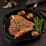 Grilled T bone steak Stock Images