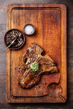 Grilled T-Bone Steak and herb butter. On wooden cutting board royalty free stock photography
