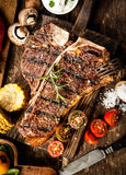 Grilled t-bone steak in a rustic kitchen Royalty Free Stock Images