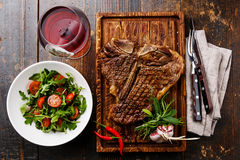 Grilled T-Bone Steak with Salad and wine Royalty Free Stock Image