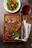 Grilled T-Bone Steak with Salad and wine Stock Photos