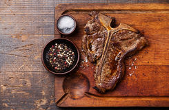 Grilled T-Bone Steak with salt and pepper Stock Images