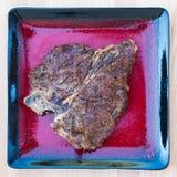 Grilled T-Bone Steak with Seasoning Royalty Free Stock Photo