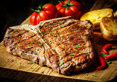 Grilled T-bone steak with vegetables royalty free stock photos