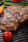 Grilled T-Bone Steak and Vegetables Royalty Free Stock Photography