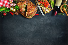 Free Grilled T-bone Steaks With Fresh Herbs And Vegetables Stock Photography - 91110632