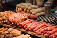 Grilled taiwanese sausages, pork enoki mushrooms Stock Photo