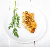 Grilled tasty chicken breasts on a white plate Royalty Free Stock Image