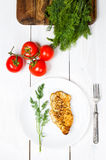 Grilled tasty chicken breasts on a white plate Royalty Free Stock Images