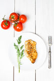 Grilled tasty chicken breasts on a white plate Stock Image