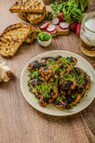 Grilled teriyaki chicken wings. With chive and microgreens on top, garlic toast with fresh herbs and czech beer Royalty Free Stock Image