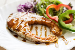 Grilled Teriyaki salmon steak with vegetables Stock Image