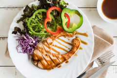 Grilled Teriyaki salmon steak with vegetables Stock Photography