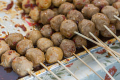 Grilled Thai meatballs on skewers with sauce for sale Royalty Free Stock Photo